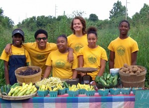 2013 Crew Members selling produce from their field at the Community Meal